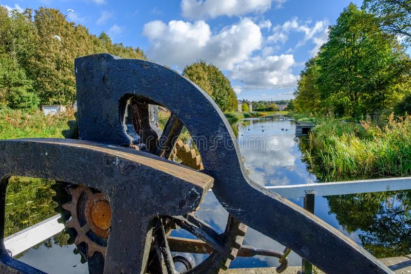 Looking over the Bridge Lock Mechanism down the old Fourth & Clyde canal in Autumn royalty free stock photos