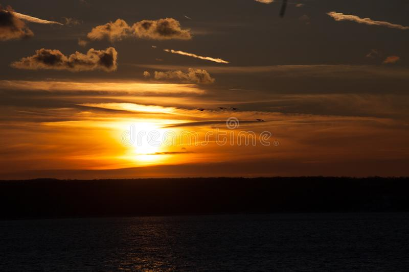 Winter Solstice Sunset over Cayuga. Looking over Cayuga Lake at the winter solstice sunset. Photo was taken on a 5 degree day from Wells College stock photography