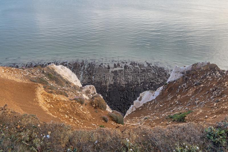 Over a Cliff Edge. Looking over a cliff edge at the sea below, in Seaford, Sussex royalty free stock photography
