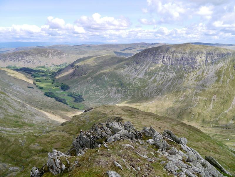 Looking over end of arete on Nethermost Pike east ridge. Ruthwaite Lodge just visible down to the right stock photography