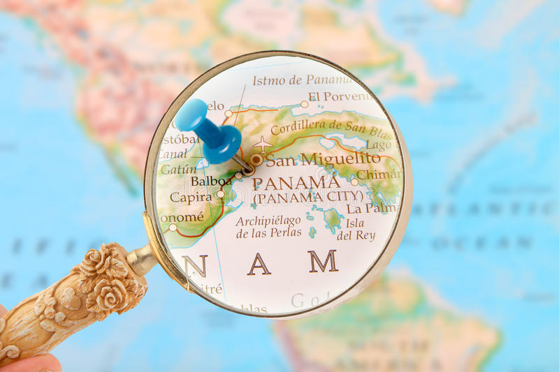 Looking in on Panama City, Central America. Blue tack on map with magnifying glass looking in on Panama City, Central America stock photo