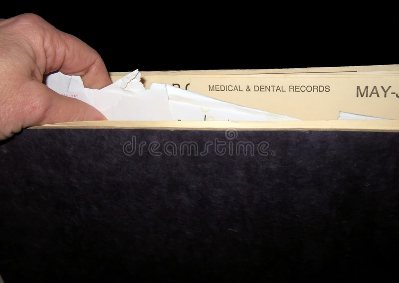 Looking through papers stock photography