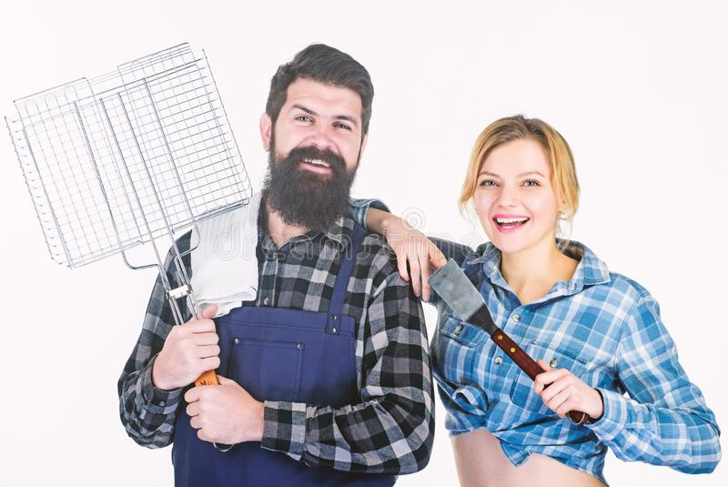 Looking perfect. Tools for roasting meat. Man bearded hipster and girl. Preparation and culinary. Family weekend. Couple. In love hold kitchen utensils. Picnic royalty free stock photography
