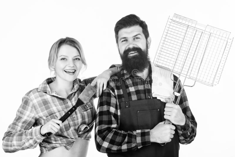 Looking perfect. Tools for roasting meat. Man bearded hipster and girl. Preparation and culinary. Family weekend. Couple stock image