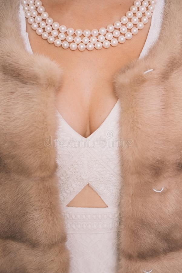 Looking posh. Fashion accessory and jewelry. Pearl necklace and mink fur. Natural pearl beads and fur. Classic retro. Style design. Vintage pearl jewelry stock photo