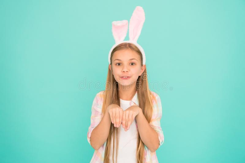 Looking pretty in easter bunny attire. Fashion accessory for easter costume party. Cute little girl wearing bunny ears royalty free stock photography