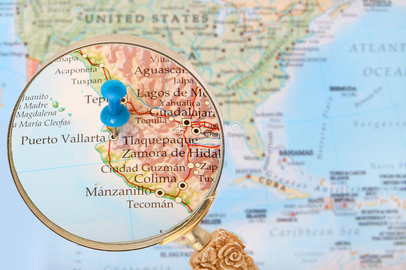 blue tack on map of north america with magnifying glass looking in on puerto vallarta mexico