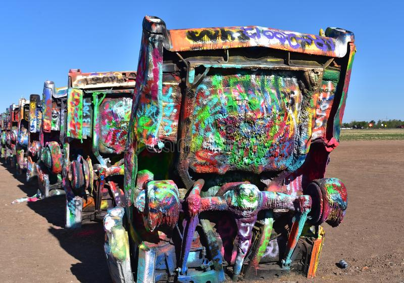 Looking at a Row of Colorfully Painted Cadillacs at Cadillac Ran. Very colorfully spray painted old cadillacs at Cadillac Ranch stock images