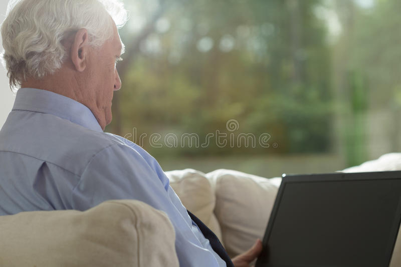Looking at the screen stock photography