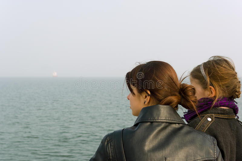 Looking at the sea. stock image