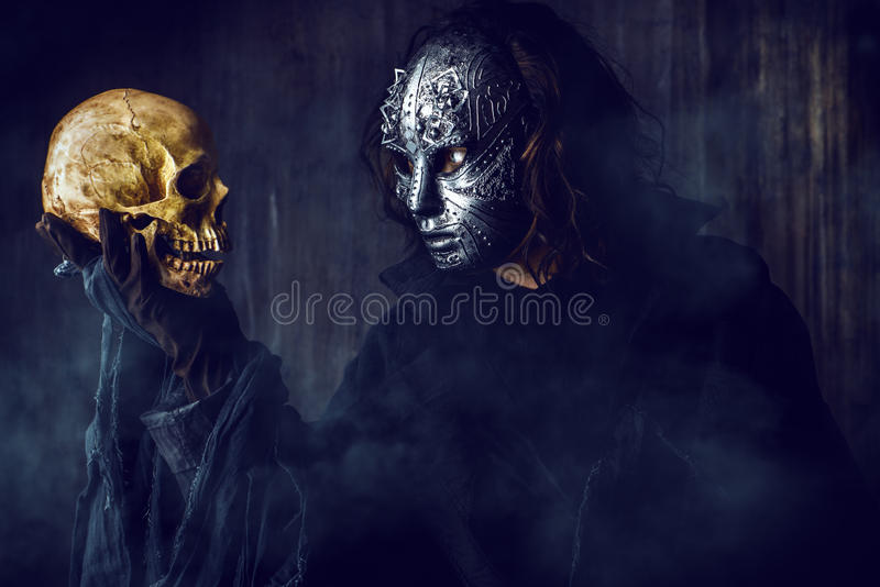 Looking on a skull royalty free stock photo