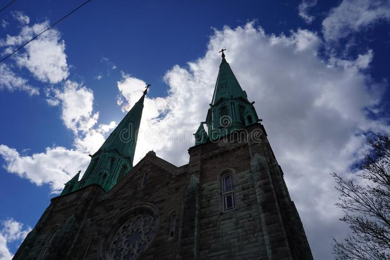 Clouds and church in Montreal stock image