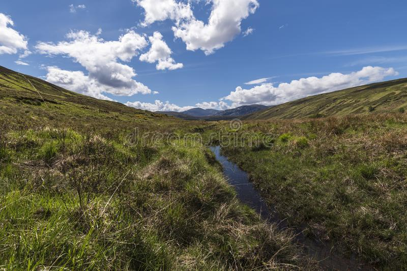 Strath More. Looking south along Strath More towards the distant mountains, Sutherland, Scotland stock photo