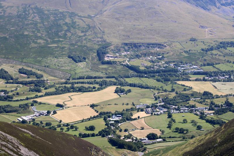 Looking down to Threlkeld from Blencathra, Cumbria. Looking south from Blencathra also known as Saddleback and down into the valley below with Threlkeld village stock photos