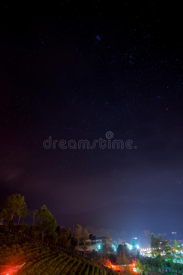 Looking the star from agriculture countryside village with a little light from lamp. Traveling in Thailand stock image