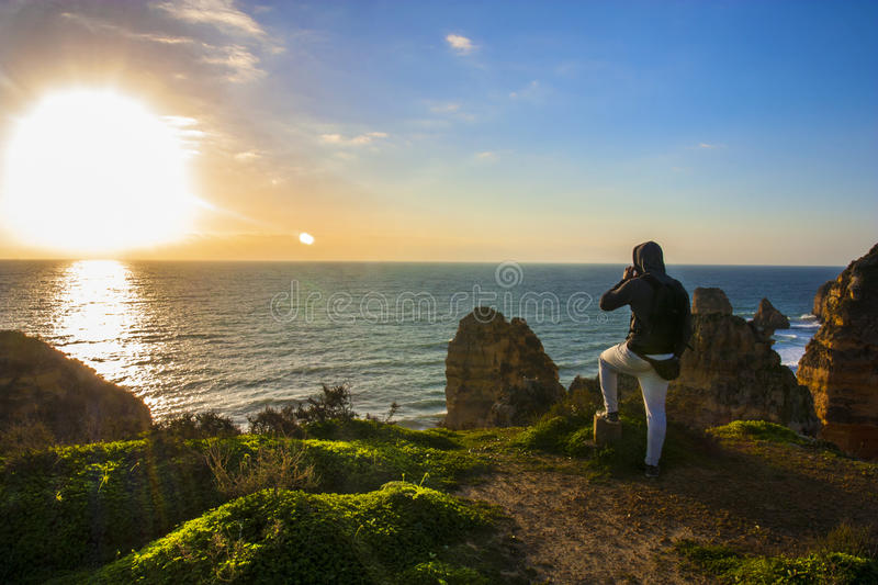 Looking at sun rise stock images