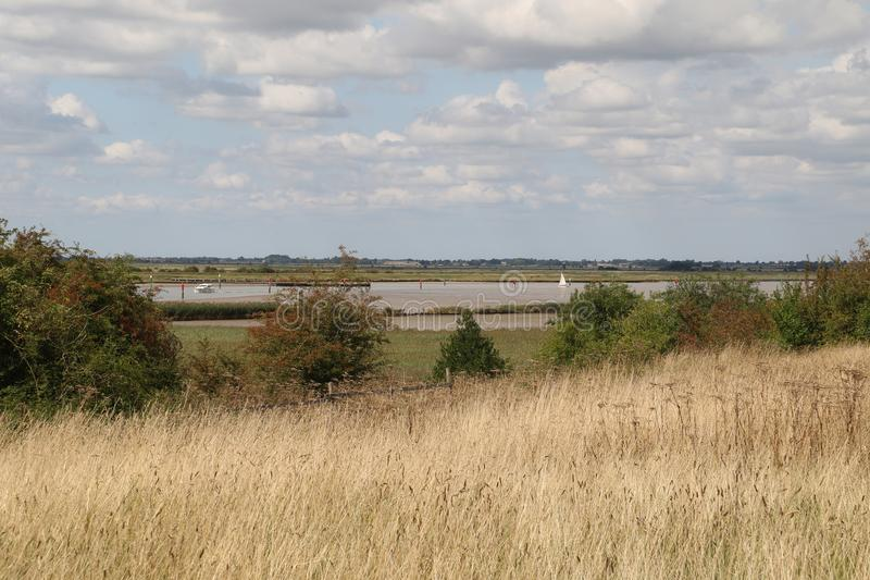 Looking towards Breydon Water. Breydon Water is a 514.4-hectare 1,271-acre biological Site of Special Scientific Interest at Great Yarmouth Norfolk. It is a royalty free stock images
