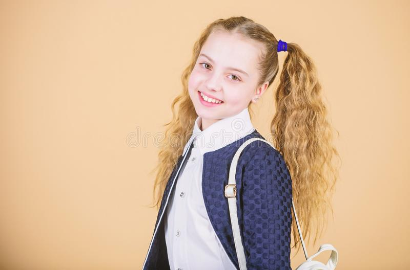 Looking trendy. Fashionable girl child. Little girl of fashion. Small girl with fashion look. Little girl with long. Blond hair in fashion style. Cute little stock image