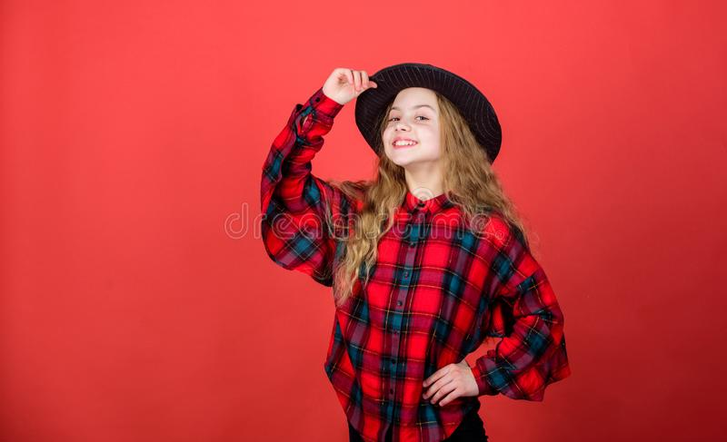 Looking trendy. Little girl with long blond hair in fashion style. Cute little fashion model. Adorable girl with fashion stock photos
