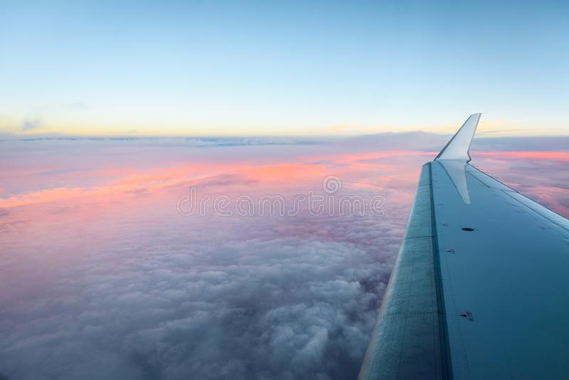 Looking trough aircraft window at the airplane wing. stock images