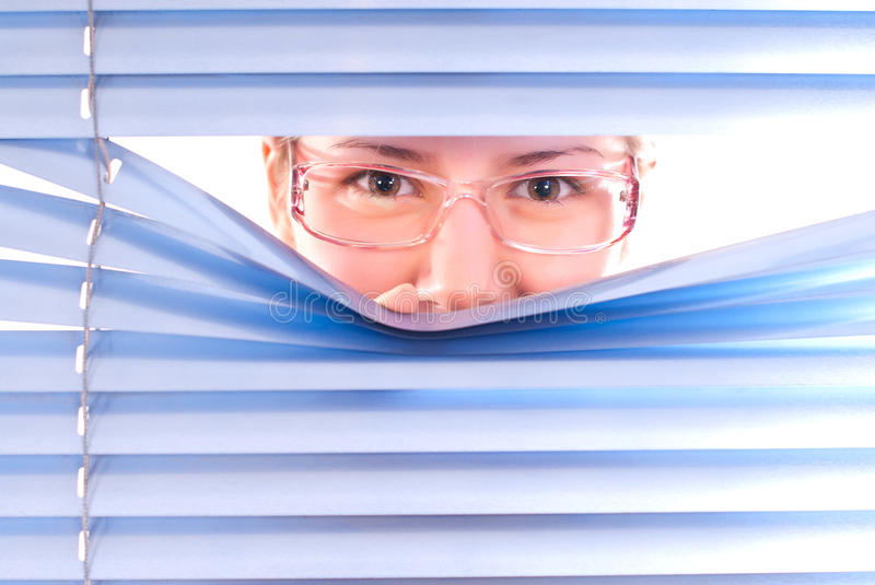 Looking trough blinds. royalty free stock image