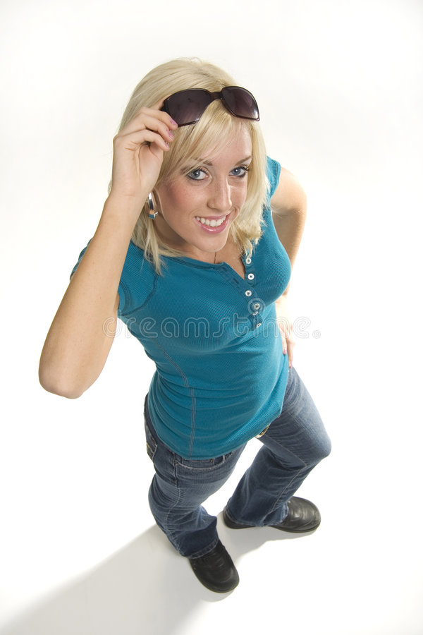 Looking up. Teenage girl raising sunglasses looking up at you stock photography