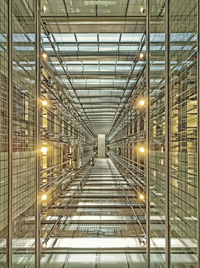 Free Looking Up An Elevator Shaft In A Modern Glass Skyscraper. Architecture, Perspective Stock Image - 131543551