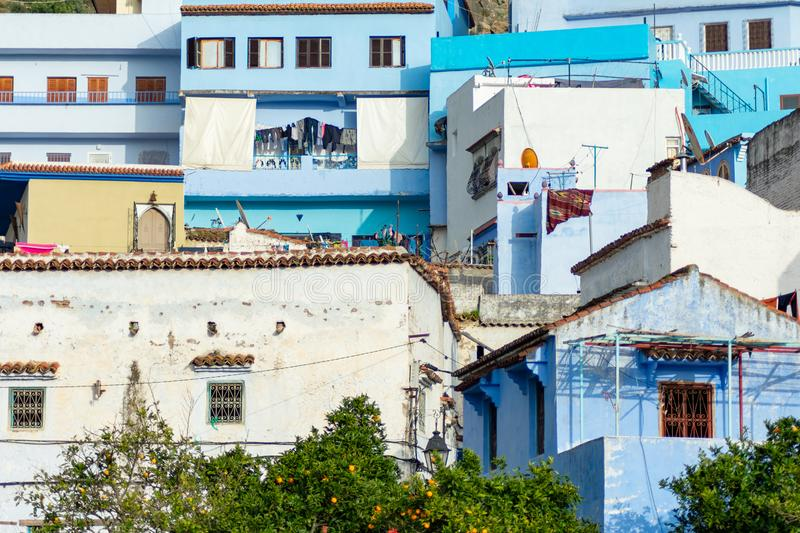 Blue and White Colored Homes and Buildings in Chefchaouen Morocco. Looking up at blue and white colored homes and buildings on a hill in the blue city of royalty free stock photos