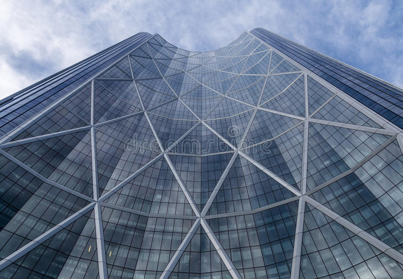 Looking up at The Bow. Calgary, Alberta/Canada – August 30, 2015: An upward view of `The Bow`, a skyscraper in Calgary, Alberta royalty free stock image