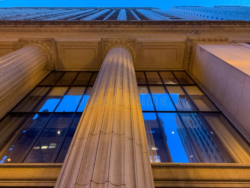 Looking up at a column-lined building in downtown Chicago Loop. During summer evening royalty free stock photos