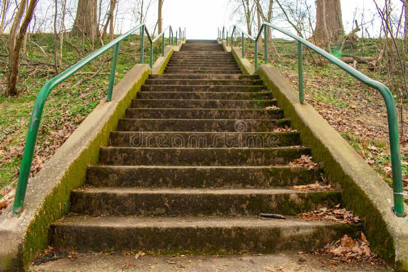 Looking Up a Concrete Stairwell in a Park. With Green Railings on Each Side stock image