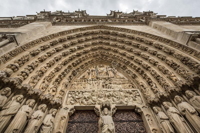 Looking up at the Gothic facade of Notre Dame de Paris Cathedral stock photography