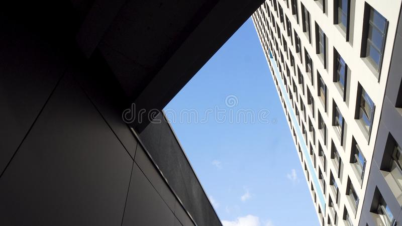 Looking up at a group of modern office buildings on blue sky background. Frame. Glass city buildings during sunny day stock photos