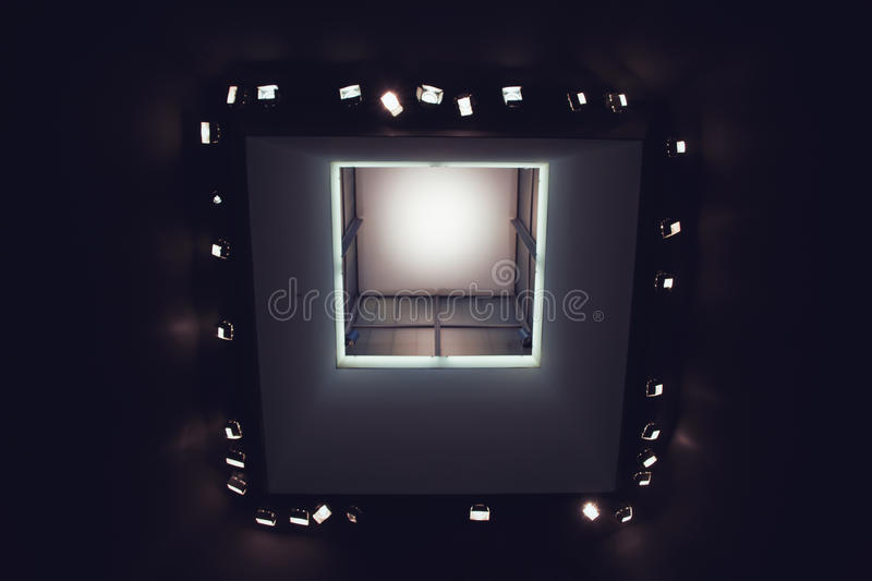 Looking up at lights in modern art museum ceiling. Looking up at the light sources in the ceiling of a museum of modern art royalty free stock photography