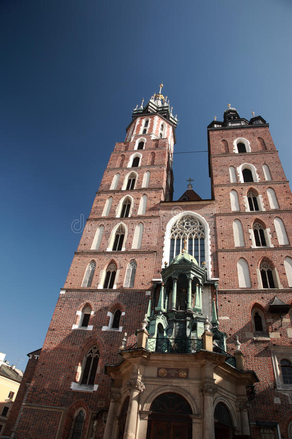 Looking up at Mariacki church, Krakow. Poland stock photos