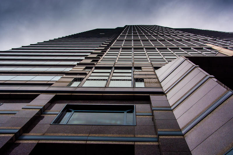 Looking up at a modern building under a cloudy sky in Philadelphia, Pennsylvania. Looking up at a modern building under a cloudy sky in Philadelphia stock photos