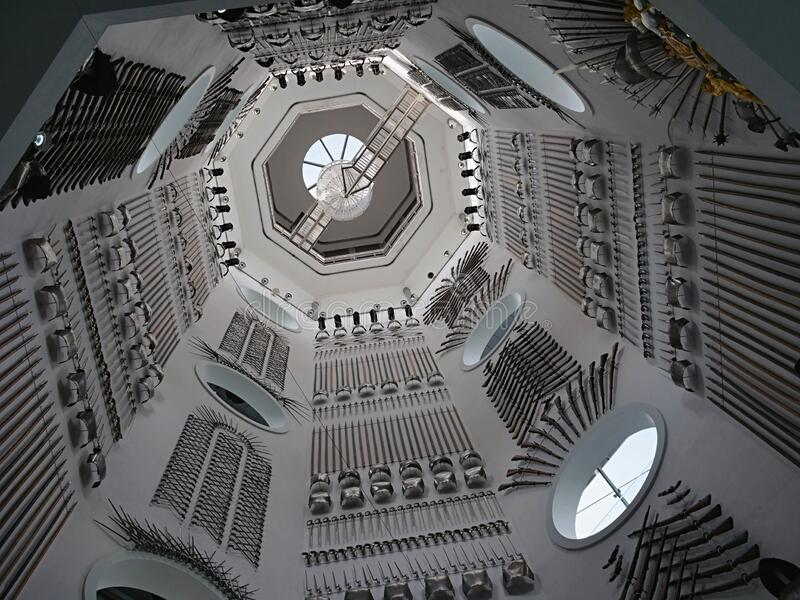 Looking up the stairwell with arms on the walls the armouries Leeds Yorkshire England. Looking up the stairwell with arms on the walls the Royal Armouries Leeds royalty free stock image