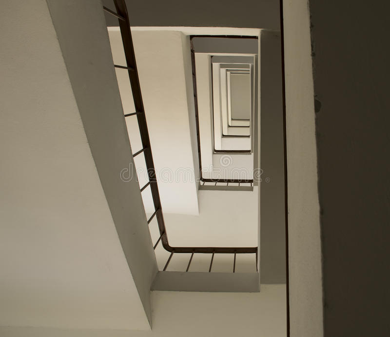 Looking up stairwell building. Abstract architecture background. Looking up stairwell interior building. Abstract architecture background stock photos