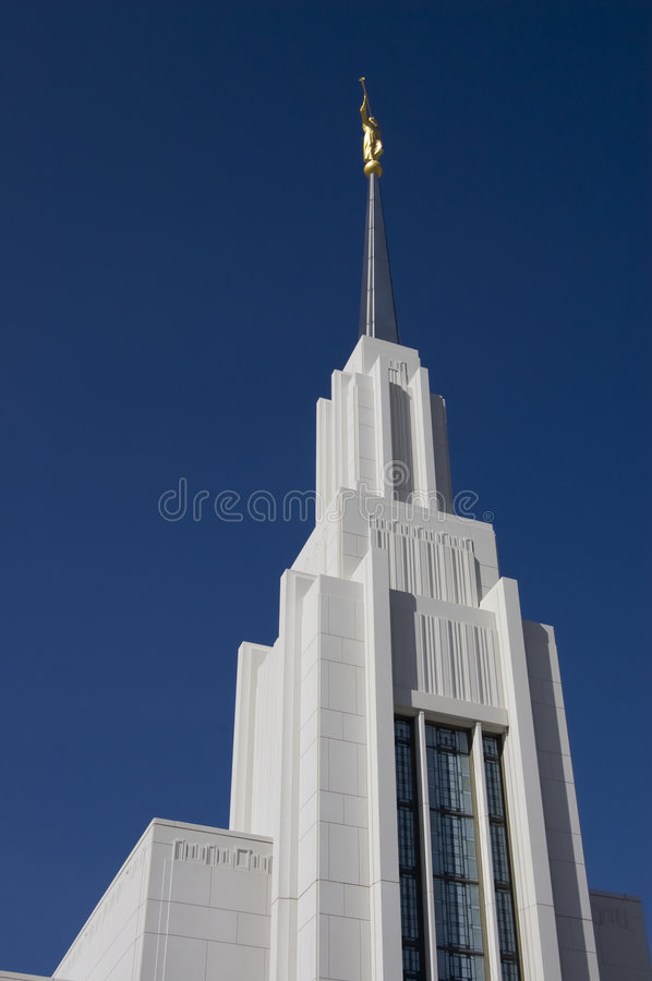 Looking up at statue of Moroni at Mormon Temple stock images