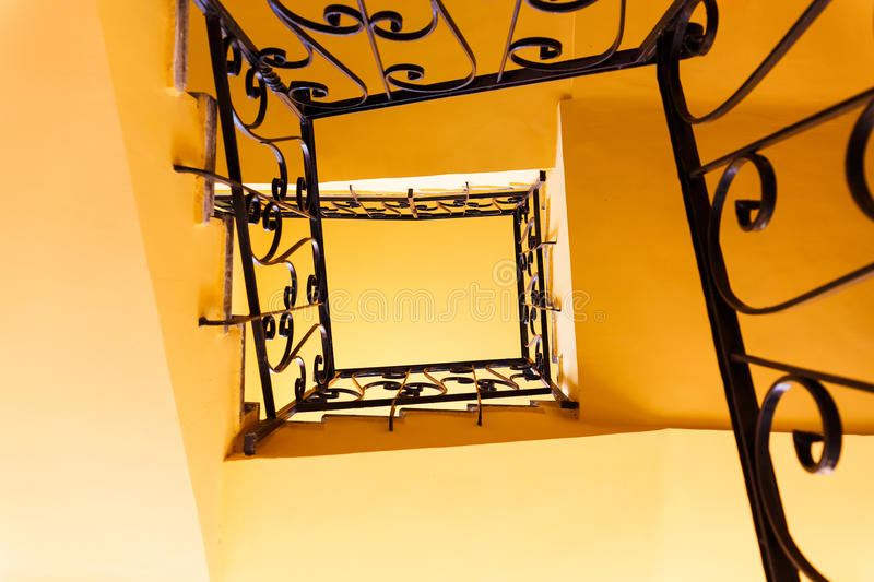 Looking up a three story staircase. In ancient building royalty free stock photos