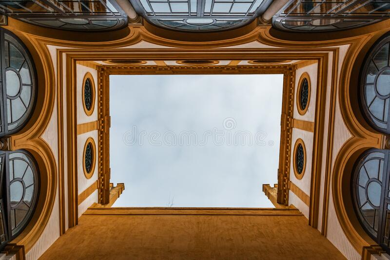 Looking up to the sky from an inner courtyard stock photography