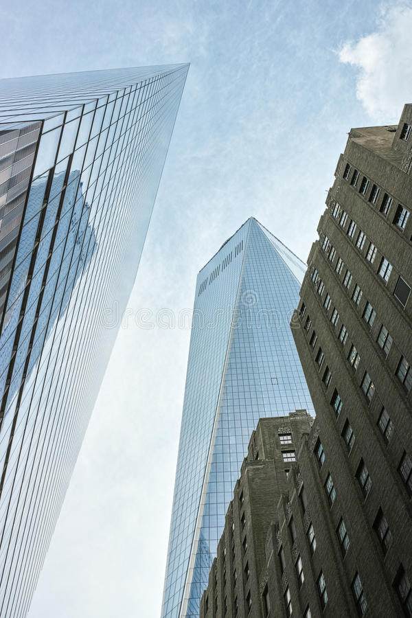 Looking up at upper part of One WTC and nearby buildings stock photo