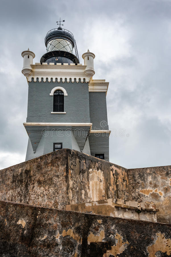 Looking up view of the lighthouse in Castillo San Felipe del Morro. With stormy sky and anient stone walls stock photos