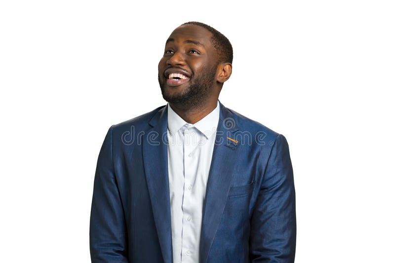 Looking upward and smiling manager. Successful afro american businessman smiling on white background. Natural human joy and happiness stock images
