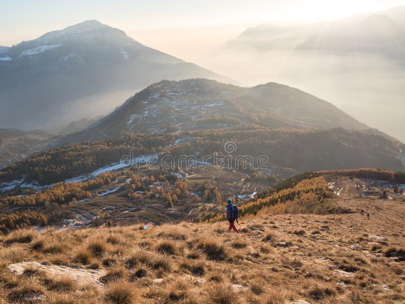 Looking at the view on Stivo mountain stock photography