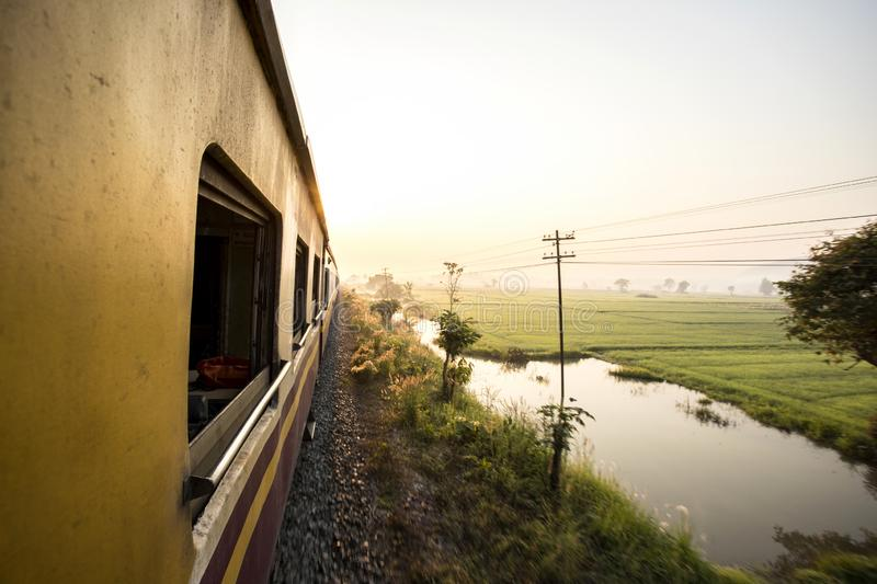 Looking at view from train window in the morning. Travel In North, Chiang Mai, Thailand adult bangkok beauty nature blurred motion caucasian ethnicity stock photo