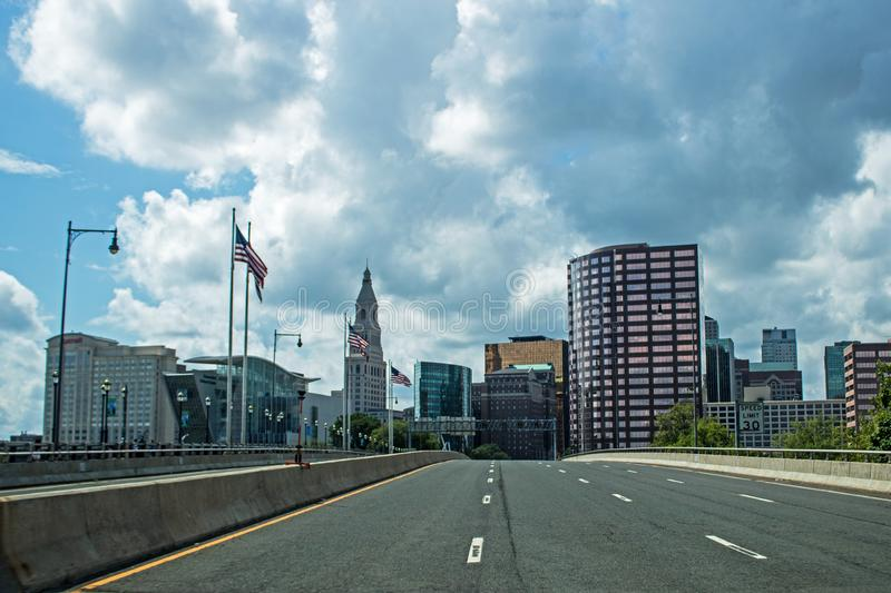 Downtown Hartford, Connecticut Skyline Crossing The Connecticut River. Looking west at the downtown Hartford, Connecticut skyline while crossing the Connecticut royalty free stock photos