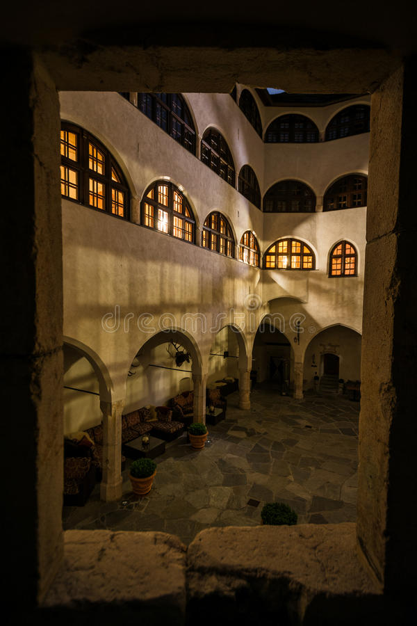 Looking Through Window of Castle Matzen over Modern Medieval Courtyard royalty free stock images