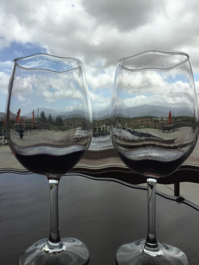 Looking through wine glasses royalty free stock images