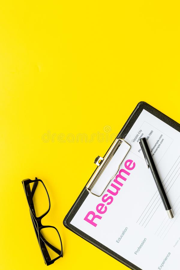 looking for work concept resume on pad near pen and glasses on
